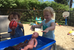 kids washing babies and balls